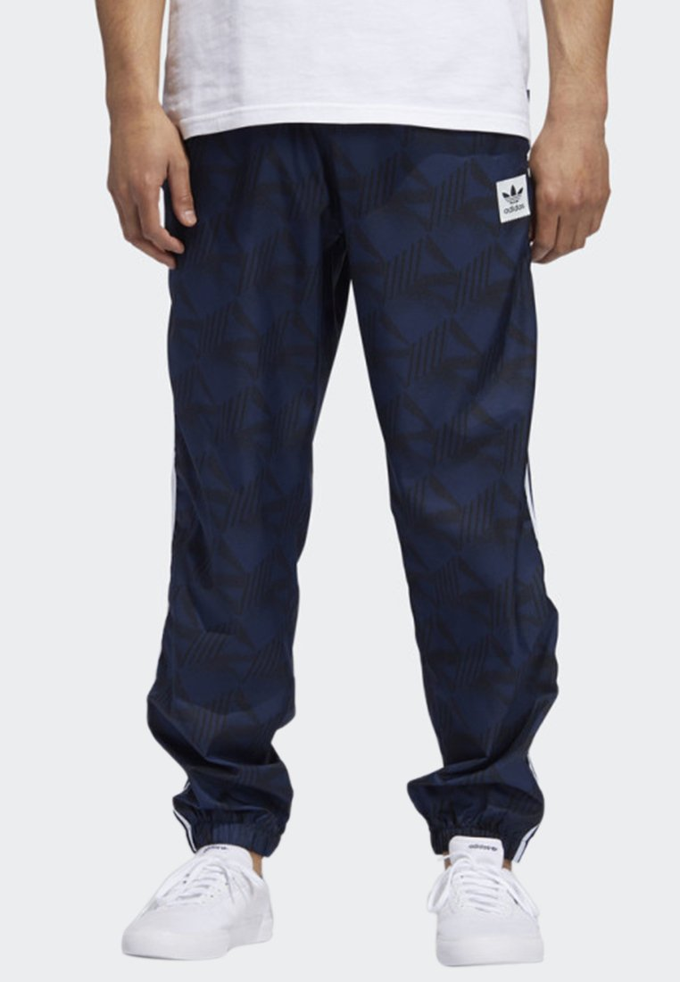adidas Originals - BOOTLEAGUE PANTS - Tracksuit bottoms - blue