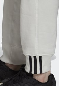 adidas Originals - JOGGERS - Tracksuit bottoms - white - 7