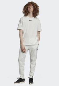 adidas Originals - JOGGERS - Tracksuit bottoms - white - 1