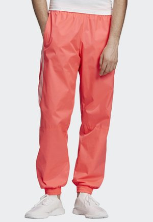 TRACKSUIT BOTTOMS - Tracksuit bottoms - orange