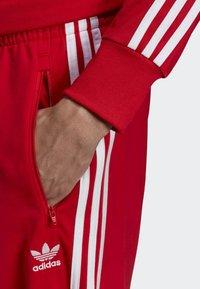 adidas Originals - FIREBIRD TRACKSUIT BOTTOMS - Träningsbyxor - red - 3