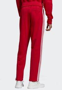 adidas Originals - FIREBIRD TRACKSUIT BOTTOMS - Träningsbyxor - red - 1