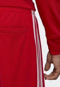 adidas Originals - FIREBIRD TRACKSUIT BOTTOMS - Träningsbyxor - red - 4
