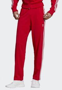 adidas Originals - FIREBIRD TRACKSUIT BOTTOMS - Träningsbyxor - red - 0