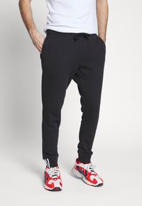adidas Originals - R.Y.V. MODERN SNEAKERHEAD SPORT PANTS - Tracksuit bottoms - black - 0