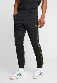 adidas Originals - CAMO - Verryttelyhousut - black/multicolor - 0