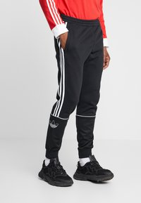 adidas Originals - OUTLINE - Pantaloni sportivi - black - 0