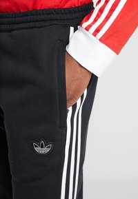 adidas Originals - OUTLINE - Pantaloni sportivi - black - 5