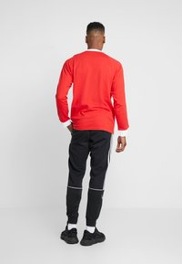 adidas Originals - OUTLINE - Pantaloni sportivi - black - 2