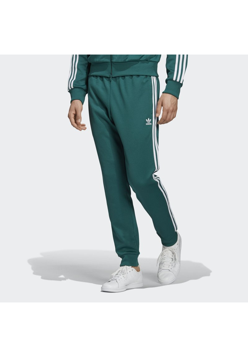 adidas Originals - SST TRACKSUIT BOTTOMS - Jogginghose - green