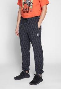 adidas Originals - TREFOIL MONOGRAM GRAPHIC SPORT PANTS - Spodnie treningowe - black - 0
