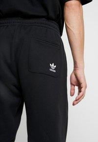 adidas Originals - ADICOLOR TREFOIL SPORT PANTS - Verryttelyhousut - black - 4