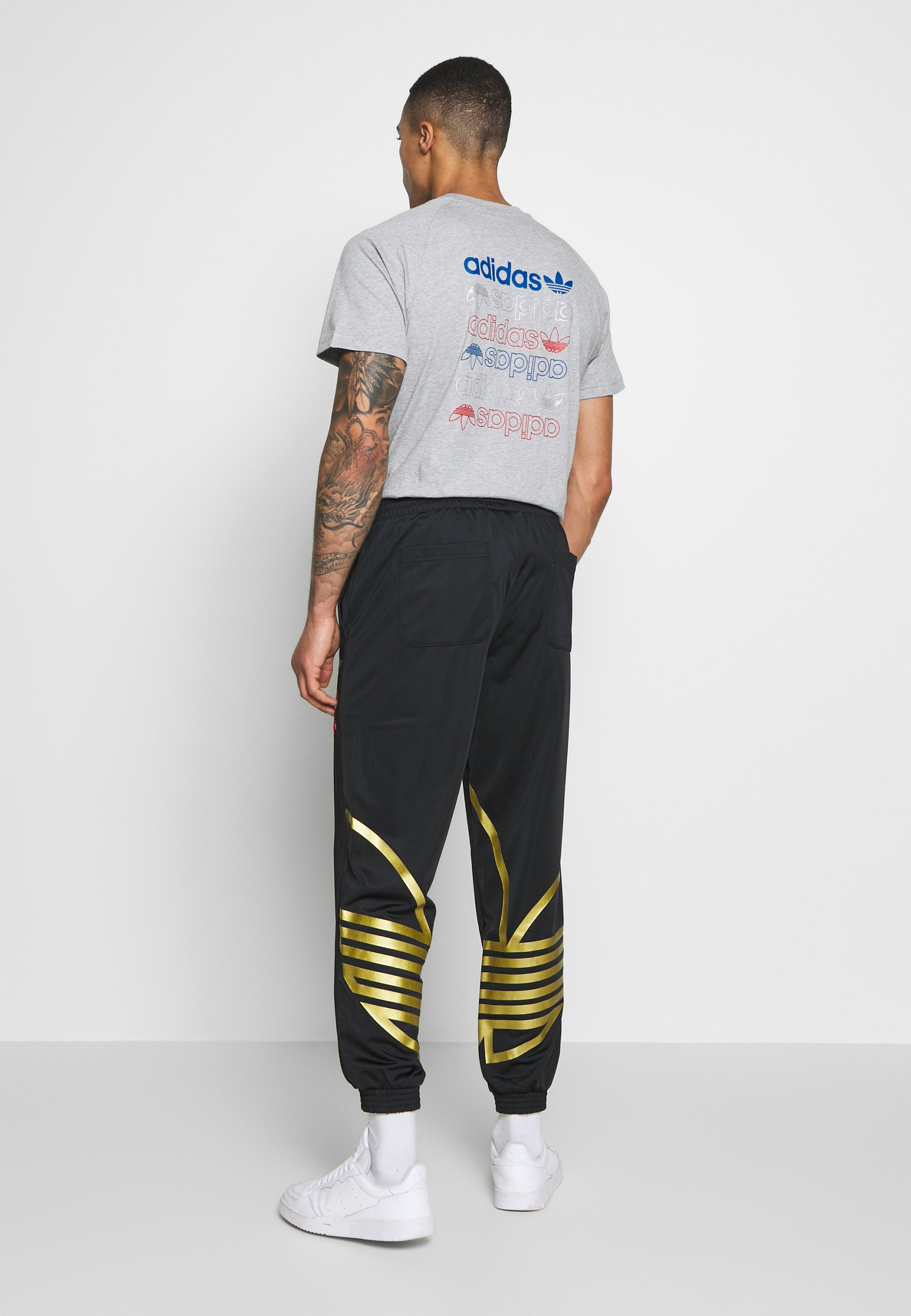 adidas Originals ADICOLOR TREFOIL TRACK PANTS - Spodnie treningowe - black