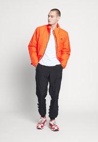 adidas Originals - ADICOLOR TREFOIL TRACK PANTS - Verryttelyhousut - black - 1