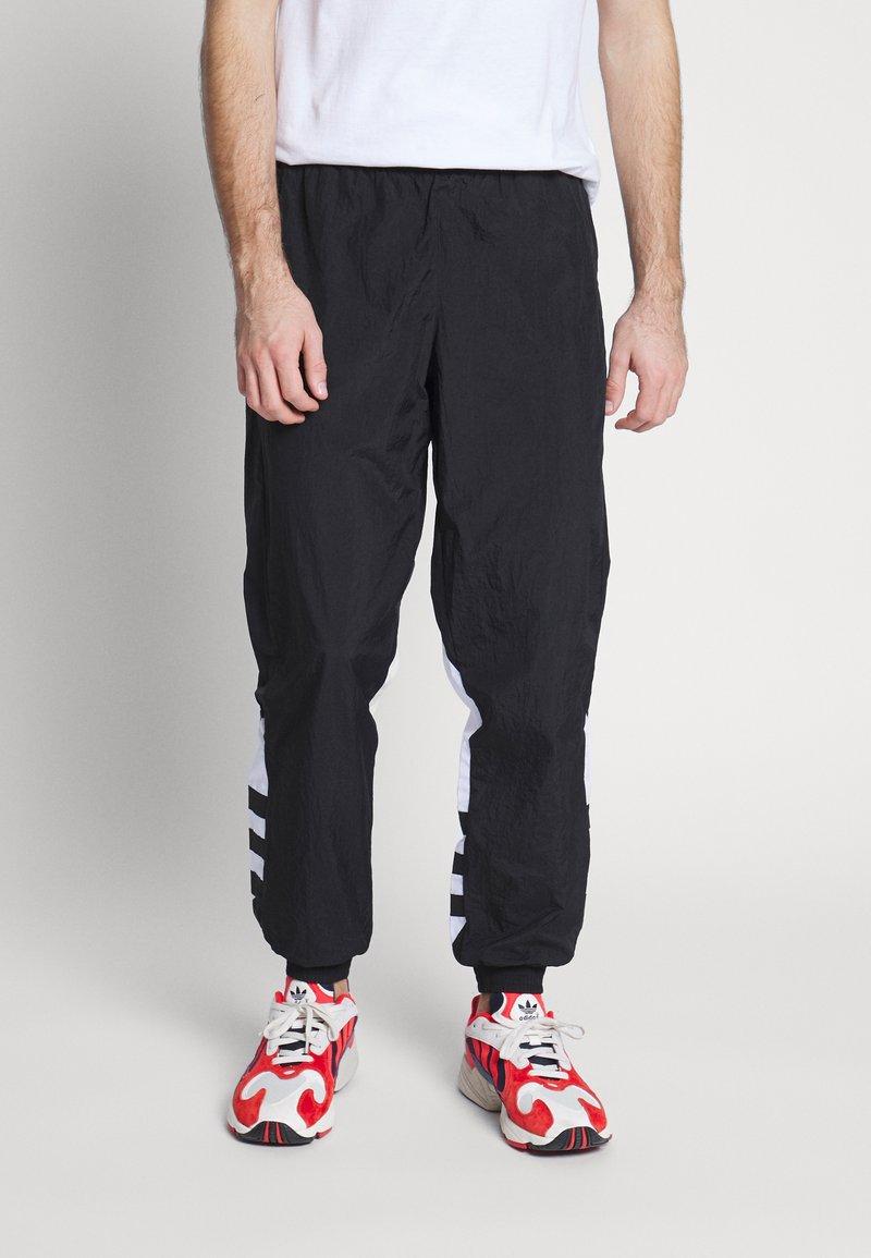 adidas Originals - ADICOLOR TREFOIL TRACK PANTS - Verryttelyhousut - black