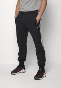 adidas Originals - 3STRIPES WRAP TRACK PANTS - Spodnie treningowe - black/white - 0