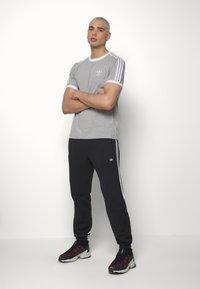 adidas Originals - 3STRIPES WRAP TRACK PANTS - Spodnie treningowe - black/white - 1