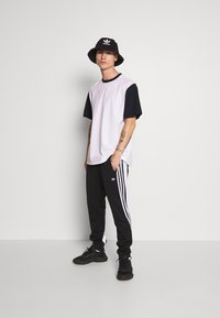 adidas Originals - 3STRIPES WRAP TRACK PANTS - Tracksuit bottoms - black/white - 1