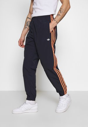 STRIPE - Tracksuit bottoms - dark blue