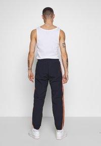adidas Originals - STRIPE - Tracksuit bottoms - dark blue - 2