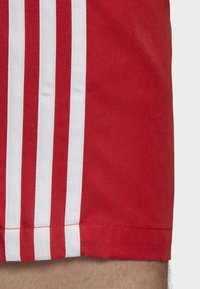 adidas Originals - 3-STRIPES SWIM SHORTS - Shorts - red - 5