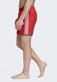 adidas Originals - 3-STRIPES SWIM SHORTS - Shorts - red - 3