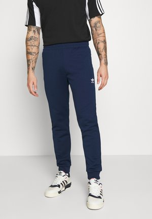 ESSENTIAL - Tracksuit bottoms - conavy