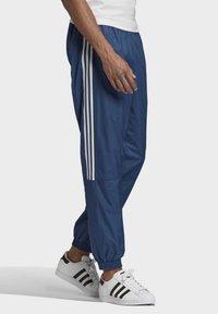 adidas Originals - TRACKSUIT BOTTOMS - Tracksuit bottoms - blue - 2