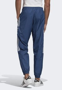 adidas Originals - TRACKSUIT BOTTOMS - Tracksuit bottoms - blue - 1