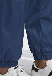 adidas Originals - TRACKSUIT BOTTOMS - Tracksuit bottoms - blue - 6