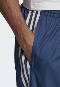 adidas Originals - TRACKSUIT BOTTOMS - Tracksuit bottoms - blue - 4