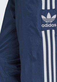 adidas Originals - TRACKSUIT BOTTOMS - Tracksuit bottoms - blue - 5