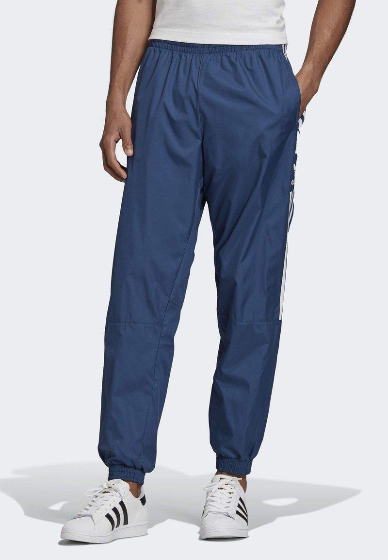 adidas Originals - TRACKSUIT BOTTOMS - Tracksuit bottoms - blue