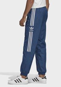 adidas Originals - TRACKSUIT BOTTOMS - Tracksuit bottoms - blue - 3