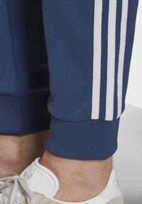 adidas Originals - TRACKSUIT BOTTOM - Tracksuit bottoms - blue - 4