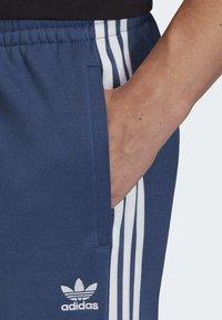 adidas Originals - TRACKSUIT BOTTOM - Tracksuit bottoms - blue - 5