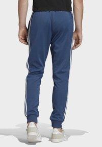 adidas Originals - TRACKSUIT BOTTOM - Tracksuit bottoms - blue - 1