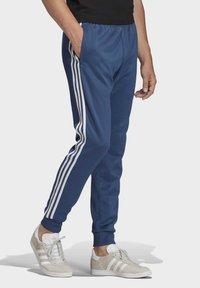 adidas Originals - TRACKSUIT BOTTOM - Tracksuit bottoms - blue - 3