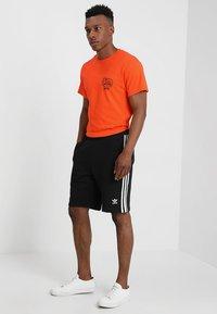 adidas Originals - 3-STRIPE - Träningsbyxor - black - 1