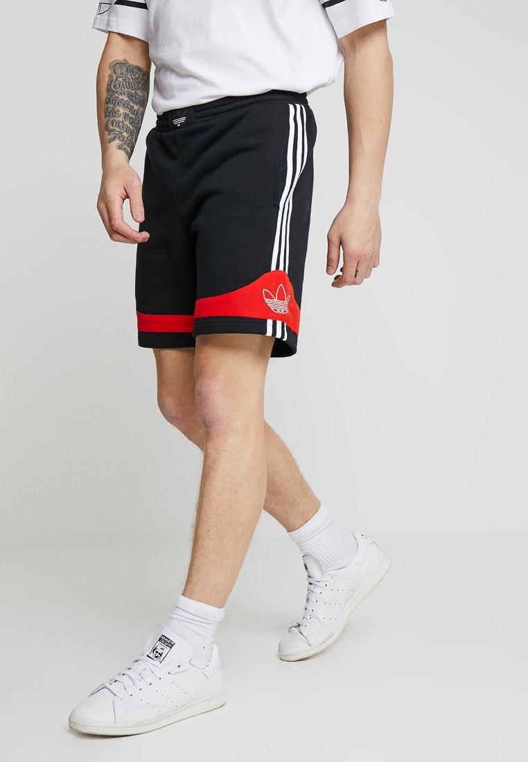 adidas Originals - OUTLINE TREFOIL REGULAR SHORTS - Tracksuit bottoms - black/core red