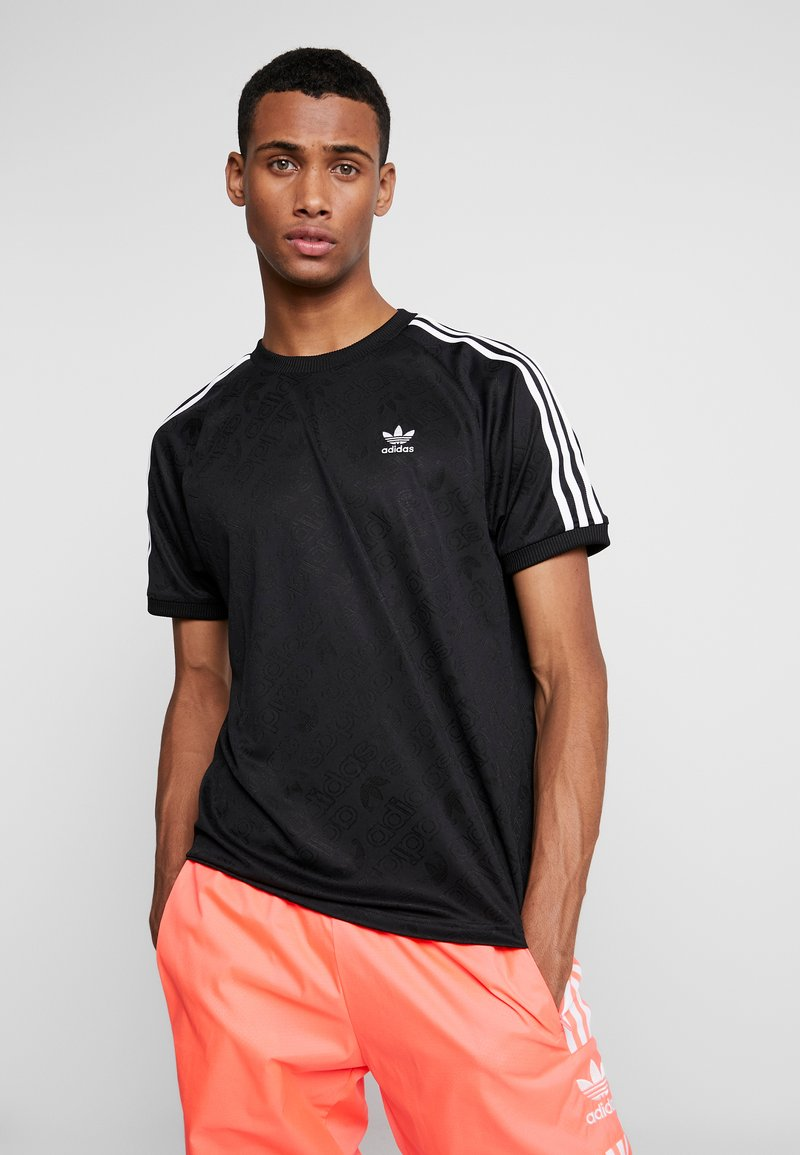 adidas Originals - MONOGRAM RETRO JERSEY - T-shirt med print - black