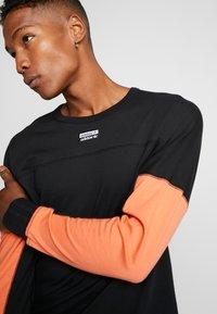 adidas Originals - REVEAL YOUR VOICE LONGSLEEVE - Longsleeve - black - 4