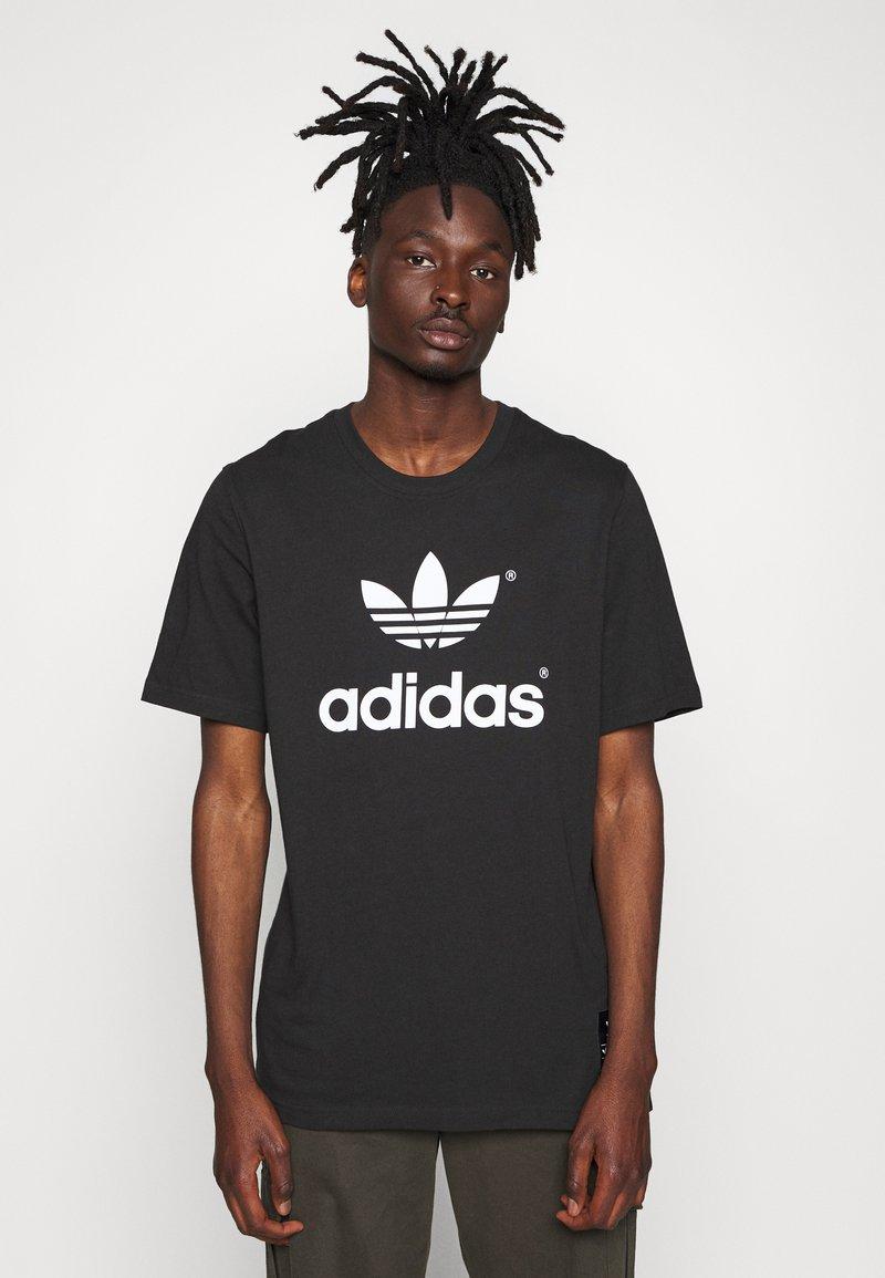 adidas Originals - TREFOIL HIST - T-shirt imprimé - black/white