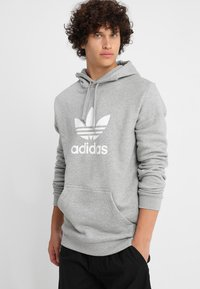 adidas Originals - ADICOLOR TREFOIL HOODIE - Luvtröja - mottled grey heather - 0