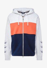 light grey/orange/navy