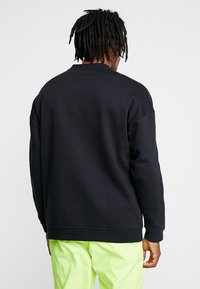 adidas Originals - ADICOLOR TECH PULLOVER - Collegepaita - black