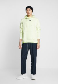 adidas Originals - REVEAL YOUR VOICE HOODY - Mikina skapucí - ice yellow - 1