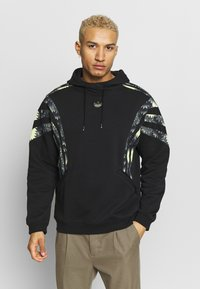 adidas Originals - FOOTBALL HOODIE - Mikina s kapucí - black - 0