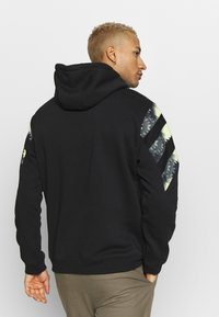 adidas Originals - FOOTBALL HOODIE - Mikina s kapucí - black