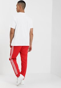 adidas Originals - Pantalon de survêtement - collegiate red - 2